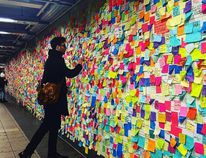 Matthew 'Levee' Chavez examines sticky notes in New York City.