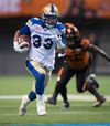 Bomber running back Andrew Harris carries the ball against the B.C. Lions during last month's playoff game. On Wednesday, Harris was named a CFL all-star. (THE CANADIAN PRESS/Darryl Dyck file photo)