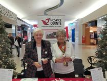 Submitted photo Hospice Quinte volunteers Cathie Price and Tettje Zuidema staff the agency's annual Memorial Trees at Quinte Mall. Over the past 17 years the trees have raised more than $55,000 for Hospice Quinte.