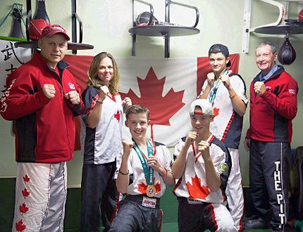 Ronda Meyer (second from left), Ewan Lindsay (third from left), Austin Walker (third from right), and Luca Meyer (second from right) of The Pitt in La Salette represented Canada at the Karate and Kickboxing Commission (WKC) World Championships in Ireland last month. Lindsay and Walker each came home with bronze medals. Also pictured are Pitt coaches Mike Hill (left) and Dennis Gurney. (Photo Courtesy Clayton Meyer)