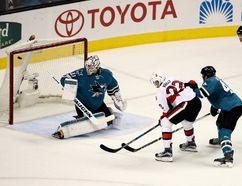 Chris Kelly of the Ottawa Senators scores a goal on Martin Jones, left, of the San Jose Sharks while defended by Marc-Edouard Vlasic, right, of the San Jose Sharks in the third period SAP Center on December 7, 2016 in San Jose, California. (Photo by Ezra Shaw/Getty Images)