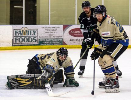 Lacombe Generals goaltender Kraymer Barnstable makes a blocker save on Red Deer College Kings shot as teammate Tanner Korchinski looks to clear the rebound during a mid-season exhibition game at the Penhold Multiplex on Saturday night. The Kings defeated the Generals 4-3 in overtime. The game was the Generals last before they make their home ice debut at the Gary Moe Auto Group Sportsplex on Friday. (Ashli Barrett/Lacombe Globe)