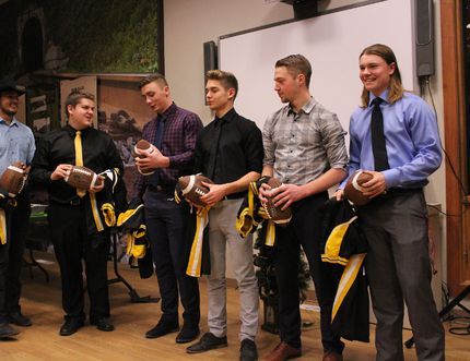 The graduating Rebels football players were awarded with personalized footballs as well as their game jerseys which they wore throughout their high school careers. (Chris Funston/Edson Leader)