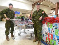 Cpl. Matt Marshall and Cpl. Kirk Lamb welcome the public to contribute new unwrapped toys for kids aged infant to 14 years in the Toys for Tots campaign at Festival Marketplace this Christmas season. SCOTT WISHART/The Beacon Herald