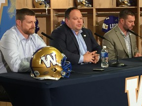 Bombers coach Mike O'Shea (left), Wade Miller (centre), and GM Kyle Walters speak at a press conference on Friday, Dec. 9, 2016. O'Shea and Walters were signed to new three-year deals by the team. It's this Canuck trio that has turned the Winnipeg franchise around — getting it to the playoffs for the first time in five years last season — and leads the Bombers into their 2017 season opener in Regina on Saturday, July 1, which also happens to be Canada's 150th birthday.(CHRIS PROCAYLO/WINNIPEG SUN/POSTMEDIA NETWORK)