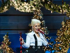 In this handout photo provided by Disney Parks, Christina Aguilera performs 'Have Yourself A Merry Little Christmas' during the taping of the 2011 Disney Parks Christmas Day Parade at Disney's Grand Californian Hotel & Spa on November 06, 2011 in Anaheim, California. The performance airs on Christmas Day.(Photo by Paul Hiffmeyer/Disney Parks via Getty Images)