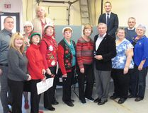 "The first annual Christmas Open House at MP Guy Lauzon's office on Pitt Street in Cornwall was held on Friday. Attendees were urged to bring non-perishable food items to support those in the community who are less fortunate, and entertainment at the event was provided by, among others, ""Guy's Christmas Girls'' singing carols, executive assistant Colin Munro on the piano, and chief of staff /vocalist Adrian Bugelli, on Friday December 9, 2016 in Cornwall, Ont. Todd Hambleton/Cornwall Standard-Freeholder/Postmedia Network"