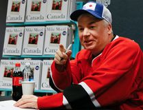 Mike Myers signs copies of his new book, Canada. (Postmedia Network)