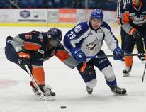 Darian Pilon, right, of the Sudbury Wolves, and Jalen Smereck, of the Flint Firebirds, fight for possession of the puck during OHL action at the Sudbury Community Arena in Sudbury, Ont. on Friday December 9, 2016. John Lappa/Sudbury Star/Postmedia Network