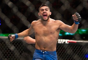 Kelvin Gastelum celebrates after defeating Jake Ellenberger, both from the United States, in a UFC 180 bout in Mexico City on Nov. 15, 2014. (AP Photo/Christian Palma)