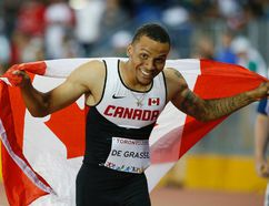 Canadian Andre De Grasse wins gold in the 100-metre final at the CIBC Athletic Centre in Toronto on July 22, 2015. (Stan Behal/Toronto Sun)