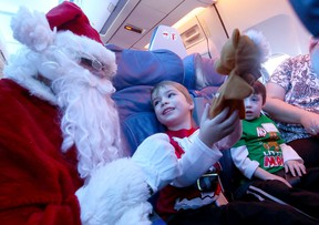 Children meet Santa as the Children's Wish Foundation and Air Transat send over a hundred kids on a flight in search of Santa on Wednesday December 7, 2016. Dave Abel/Toronto Sun