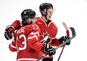 Canada's Mathew Barzal celebrates his team's win over Switzerland with teammate Thomas Chabot in preliminary round hockey action at the IIHF World Junior Championship in Helsinki, Finland on Dec. 29, 2015. (THE CANADIAN PRESS/Sean Kilpatrick)