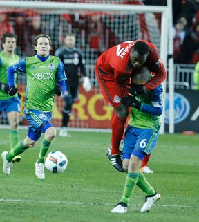 TFC's Jozy Altidore and Osvaldo Alonso of Seattle as Toronto FC hosts Seattle Sounders for the MLS Cup at BMO Field in Toronto, Ont. on Saturday December 10, 2016. Michael Peake/Toronto Sun/Postmedia Network