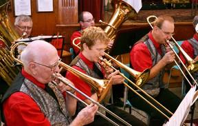 The Mitchell Legion Band performed at its annual Christmas Concert last Tuesday, Dec. 6 at the Crystal Palace. Art Heimpel (left), Jon Michael Falconer and Andrew Checinski on trombones play 'Joy to the World' along with the rest of the band. GALEN SIMMONS MITCHELL ADVOCATE