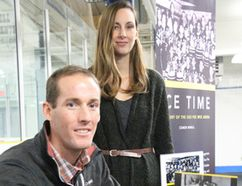 Author Conor Mihell and cover designer Jessica Glemnitz were at a Pee Wee Arena book launch.