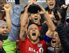 Vaughn Ridley/Getty Images Michael Bradley #4 of Toronto FC and teammates celebrate with the Eastern Conference Trophy following the MLS Eastern Conference Final, Leg 2 game against Montreal Impact at BMO Field on Nov. 30 in Toronto.