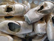 Ballet slippers used in both rehearsals and performances in a basket in the wardrobe department for the Alberta Ballet. (Ted Rhodes/Postmedia Network File Photo)