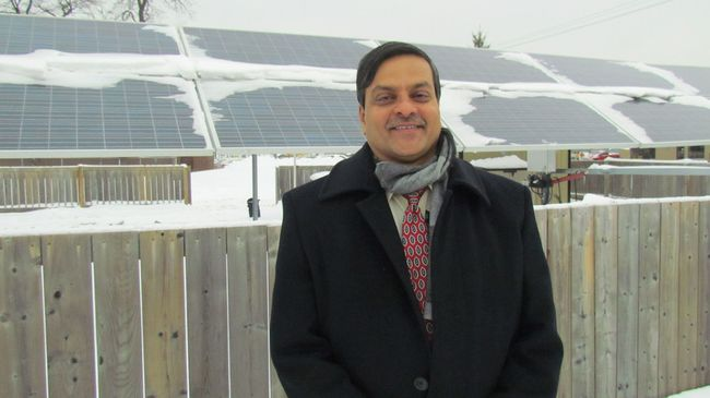 Western Engineering professor Rajiv Varma stands next to solar panels at the Bluewater Power offices in Sarnia Tuesday. Varma led several years of research in partnership with the Sarnia electricity utility to make use of solar farms at night to increase stability and performance of the electricity grid. (Paul Morden/Sarnia Observer/Postmedia Network)