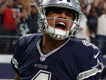 Dak Prescott #4 of the Dallas Cowboys celebrates after scoring a touchdown during the fourth quarter against the Washington Redskins at AT&T Stadium on November 24, 2016 in Arlington, Texas. (Photo by Tom Pennington/Getty Images)