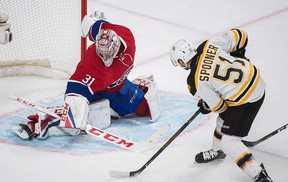 Boston Bruins' Ryan Spooner scores on Montreal Canadiens' Carey Price during overtime in Montreal on Dec. 12, 2016. (THE CANADIAN PRESS/Graham Hughes)