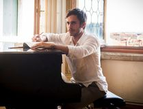 """This image released by Amazon Prime Video shows Gael Garcia Bernal in a scene from """"Mozart in the Jungle."""" All 10 episodes of season three will be available on Amazon on Friday. (Christopher Raphael/Amazon Prime Video via AP)"""