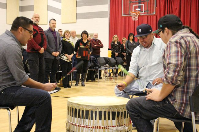 Aamjiwnaang First Nation members Lightning Clark, Matt Isaac and Nim Plain drum for a crowd of local dignitaries gathered at the Maawn Doosh Gumig Community and Youth Centre Wednesday. Community leaders gathered for the signing of a new water and sewer service agreement between the City of Sarnia and Aamjiwnang First Nation. Barbara Simpson/Sarnia Observer/Postmedia Network