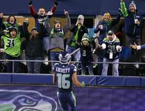 Seahawks fans cheer Tyler Lockett on his touchdown against the Panthers early in the second half of an NFL game in Seattle on Dec. 4, 2016. (Stephen Brashear/AP Photo)