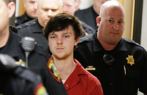 In this Feb. 19, 2016 file photo, Ethan Couch is led by sheriff deputies after a juvenile court for a hearing in Fort Worth, Texas. Couch's father, Fred, was convicted of falsely identifying himself as a peace officer. (AP Photo/LM Otero, File)