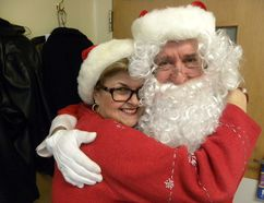 Ernst Kuglin/The Intelligencer Santa gets a hug from Trenton Memorial Hospital Foundation executive director Wendy Warner at Thursday's Our TMH Christmas appreciation luncheon for hospital staff and members of auxiliary.
