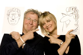 Sun cartoonists Andy Donato and Sue Dewar pose with cartoons of themselves in this file photo. (Postmedia Network files)