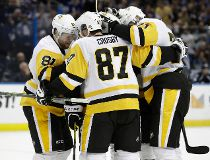 Pittsburgh Penguins center Sidney Crosby (87) celebrates with teammates, including Phil Kessel (81), after scoring against the Tampa Bay Lightning during the third period of an NHL hockey game Saturday, Dec. 10, 2016, in Tampa, Fla. (AP Photo/Chris O'Mear