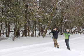 Jeff Skevington (left) and Liz Purves (right) trekked through chest-deep snow near a marsh during the first few hours of Oxford's Christmas Bird Count on Saturday, Dec. 17, 2016. Highlights included a Kingfisher diving for fish and a Northern Shrike sighting. (MEGAN STACEY/Sentinel-Review)