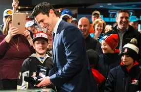 Pittsburgh Penguin Sidney Crosby holds a 2016 Stanley Cup ring at the Hockey Hall of Fame on Yonge St. (ERNEST DOROSZUK, Toronto Sun)