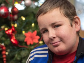 Alex Tourangeau, 13, recently completed 1,152 doses of chemotherapy as part of his treatment for leukemia, which lasted three years.   Wayne Cuddington/ Postmedia