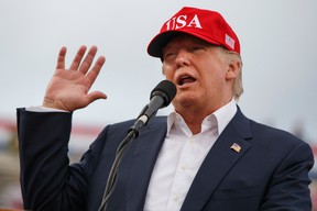 In this Saturday, Dec. 17, 2016 file photo, U.S. President-elect Donald Trump speaks during a rally at Ladd-Peebles Stadium in Mobile, Ala. (AP Photo/Evan Vucci, File)