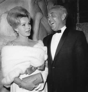 """In this April 10, 1963, file photo, actress Zsa Zsa Gabor and Herbert Hutner arrive for the New York premiere of the film """"The Ugly American."""" (AP Photo/Marty Lederhandler, File)"""