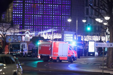 Rescue workers arrive to the area after a truck plowed through a Christmas market on Dec. 19, 2016 in Berlin, Germany. (Sean Gallup/Getty Images)