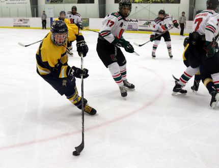 Colby Winia, left, of the GPAC TEK Plumbing & Heating Midget AA Storm, turns around in the offensive zone with the puck against the SSAC Midget AA Lakewood Chevrolet on Saturday Dec. 17 at the Crosslink County Sportsplex, north of Grande Prairie. The Storm tied 3-3. Logan Clow/Daily Herald-Tribune