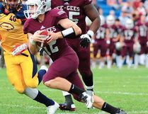 Belleville's Derek Wendel carries the ball for the Ottawa Gee Gees vs. the Queen's Golden Gaels during the 2016 OUA football season. (OUA photo)