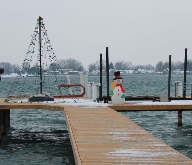 A snowman languidly sits beside a Christmas tree light display on a dock in Sombra. The Sombra Volunteer Garden Club encouraged village residents who live along the St. Clair to put up decorated, well-lit Christmas trees along the river as part of their Light Up The St. Clair initiative. 