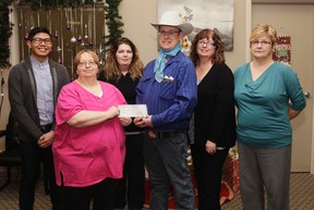 Curtis Anderson donates $1,647 to FOCUS Vermilion on Tuesday, December 13, 2016, in Vermilion, Alta. The donation was raised by the Second Chance Trail Ride earlier this year. Taylor Hermiston/Vermilion Standard/Postmedia Network.