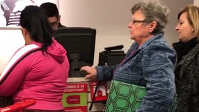 A still frame shows a holiday shopper in the States going on a racist tirade against a fellow customer.