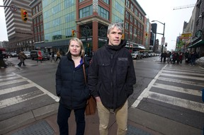 Poverty researchers Tracy Smith Carrier and Don Kerr, stand at Dundas and Richmond streets, the location of an Ontario Works office in downtown London. New information shows the rate of people on social assistance in the wider London area has far outstripped its population growth rate over the past decade. (CRAIG GLOVER, The London Free Press)