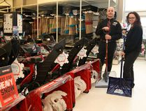 Aaron Winch, left, and Laurie McVittie, of the New Sudbury Canadian Tire, show a selection of snowblowers and shovels available at the store in Sudbury. John Lappa/Sudbury Star/Postmedia Network