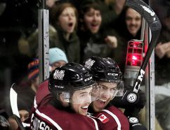 Chatham Maroons' Braden Henderson (4) celebrates with Ethan Sarfati after scoring on the Strathroy Rockets in the first period Thursday at Memorial Arena. (MARK MALONE/The Daily News)