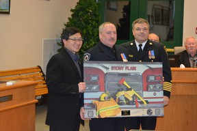 Kimball Scott stands with Stony Plain Mayor William Choy, left, and Fire Chief Trevor Mistal, right, when he was recognized for 20 years of service during a regular council meeting on Dec. 5. - Photo submitted