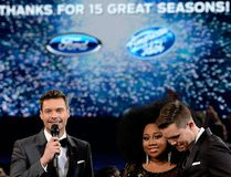 """American Idol"" Season 15 winner Trent Harmon (R), host Ryan Seacrest (L) and finalist La'Porsha Renae speak onstage during FOX's ""American Idol"" Finale For The Farewell Season at Dolby Theatre on April 7, 2016 in Hollywood, Calif. at Dolby Theatre on April 7, 2016. (Kevork Djansezian/Getty Images)"
