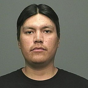 Tyron Custer Harper, 23, should not be approached if seen on the street, said police. (WINNIPEG POLICE SERVICE PHOTO)