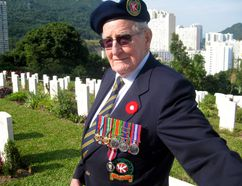 Ken Pifher marks Remembrance Day in 2012 at Sai Wan Cemetery in Hong Kong, the final resting place of nearly 300 Canadians killed defending the former British colony from Japanese invaders in 1941. (Postmedia Network)